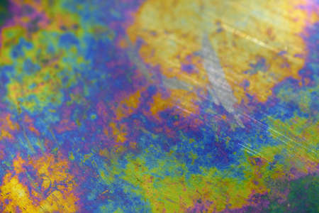 Iridescent surface of a metallic plate (background) Stock Photo