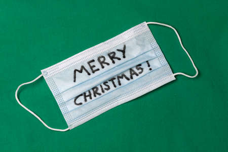 Merry Christmas written on disposable face mask