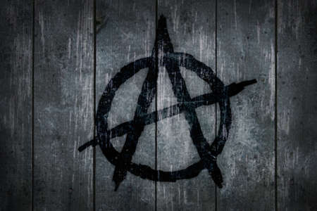 anarchy: anarchy symbol on wooden background