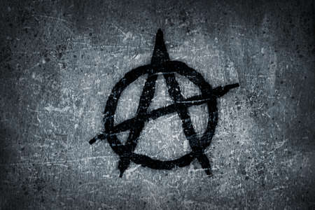 meanness: anarchy symbol on grunge background