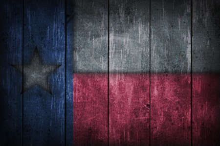 texas state flag: texas flag on old wooden wound
