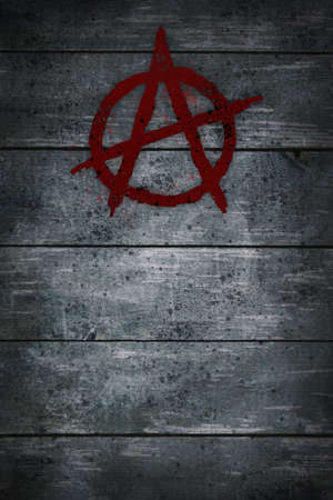 anarchy symbol on wooden background photo