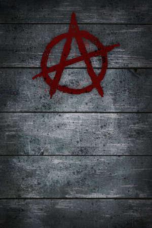 anarchy: anarchy symbol on wooden background
