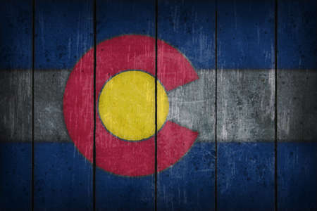 wound: colorado flag on old wooden wound