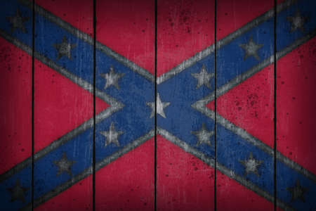 confederate: Confederate National Flag on old wooden wound