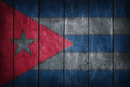 cuba flag painted on old wooden wound photo