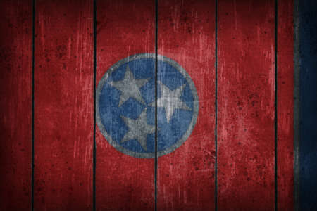 tennessee flag on old wooden wound photo