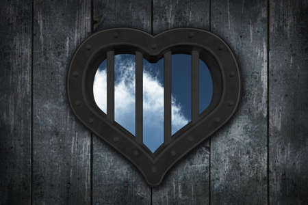 security council: heart prison window on wooden planks background - 3d illustration Stock Photo