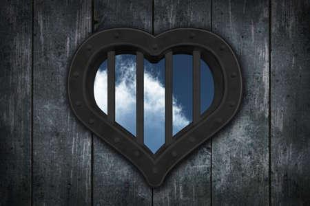jail cell: heart prison window on wooden planks background - 3d illustration Stock Photo