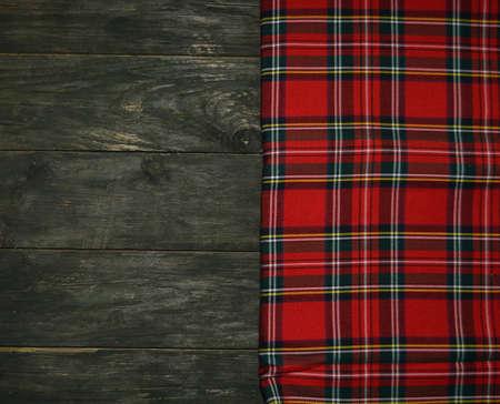 tartan textile on wooden background photo