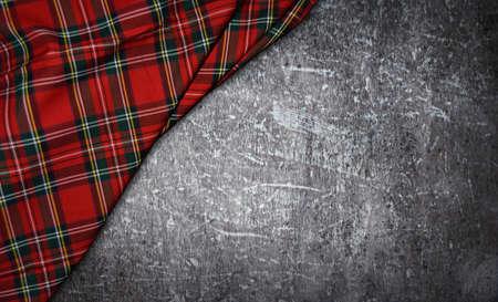 tartan textile on stone background Standard-Bild