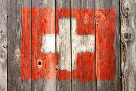 swiss colors painted on old wooden wound