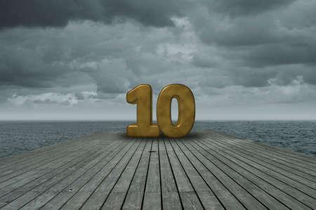Número diez en el piso de madera en el océano Foto de archivo - 89448972