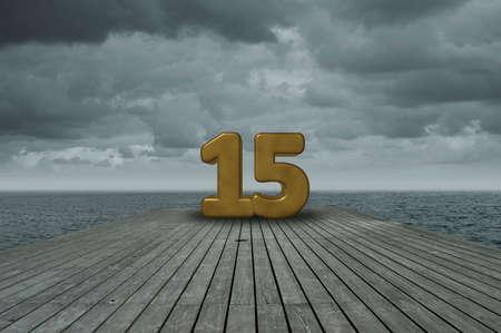 fifteen year old: number fifteen on wooden floor at ocean Stock Photo