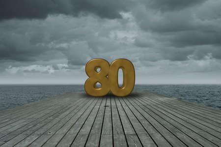 Number eighty on wooden floor at ocean