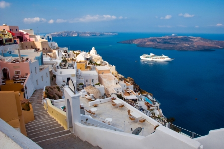 thira: The island of Santorini  Morning view of the harbor, the volcano and Thira