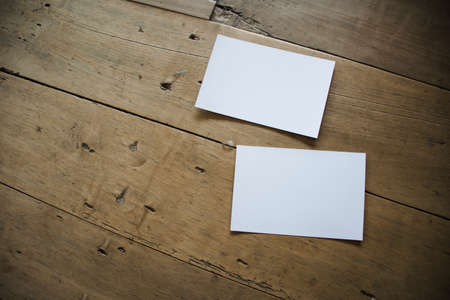 top view of white postcard or papers on old wooden background Imagens