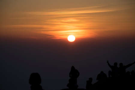 silhouette people looking to sunset on mountain for background