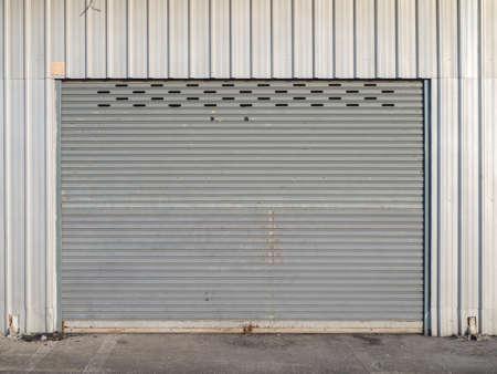 front view of grunge close shutter door or rolling door 版權商用圖片