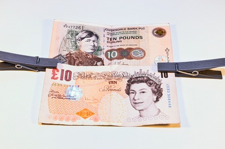 pounds: british and scottish pounds stapled together