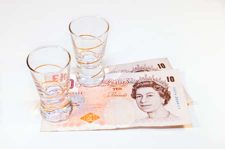 pounds: two vodka glasses on banknotes ten pounds