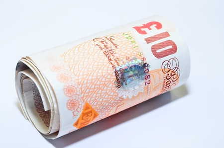 pounds: British banknotes pounds sterling rolled UK England