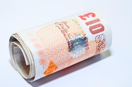 British banknotes pounds sterling rolled UK England