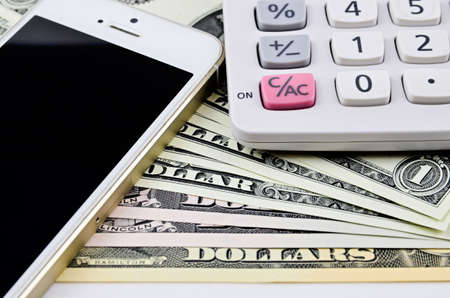costly: shows that using of mobile phone is costly shows calculator Stock Photo