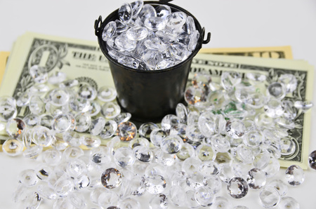 us dollars: US Dollars covered with diamonds and bucket