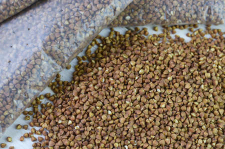 groats: buckwheat groats loose and packed Stock Photo