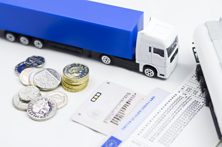 trucker: Tachograph with lorryshows its good way to earn proper wage Stock Photo