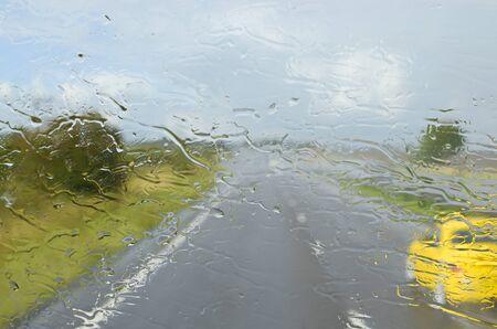 windscreen: Close-up rain on windscreen during sunny day
