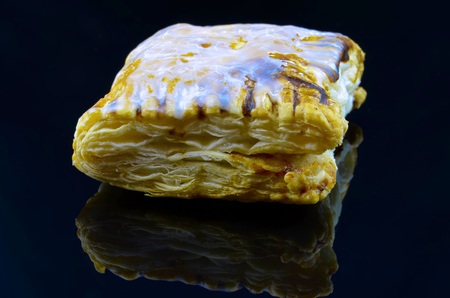 sugarcoated: Crisp puff pastry filled with jam sugar-coated on black background