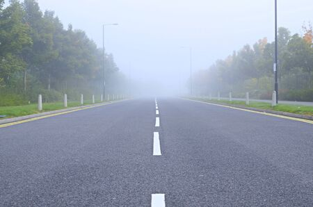 road conditions: Asphaltic road during fog conditions, poor visibility. Industry estate road in England