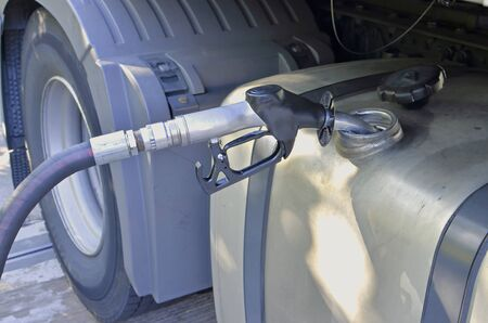 refuelling diesel to lorry tank, large hose nozzle