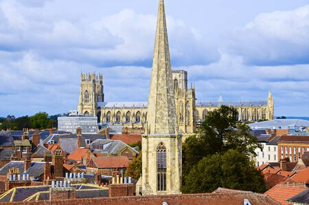 york minster: Looking out at the view from the top of Cliffords Tower in York. Include York Minster, St Wilfrids Catholic Church Editorial