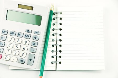 note book: A note book with pencil and calculator