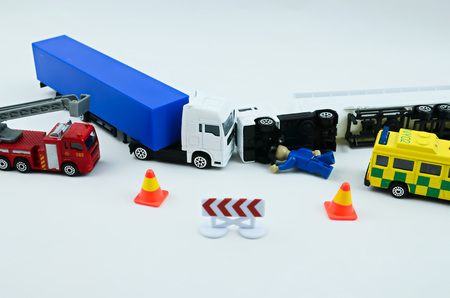road accident: Road accident crash  shows by toys, lorry accident, broken toys lorry Stock Photo