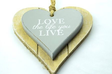 love life: Hanging decoration with pearl of wisdom. Love the life you live
