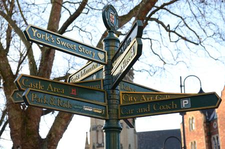 visitors: Historic direction sign for visitors in York UK