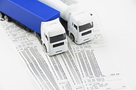 Digital tachograph printed day shift against two lorry