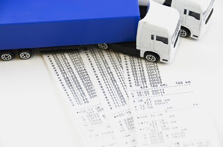 shift: Digital tachograph printed day shift against two lorry