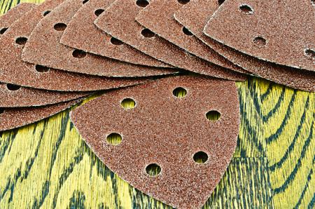 sandpaper: Detail of sandpaper on wooden background