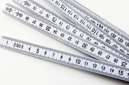 yardstick: Plastic folding yardstick, ruler on white background