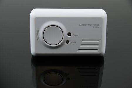 Carbon monoxide alarm on black background.