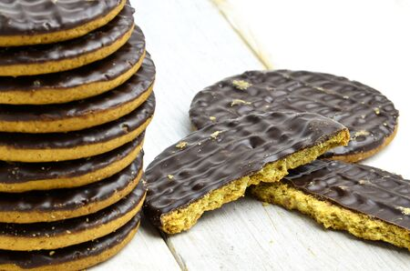 biscuits: Pile chocolate covered digestive biscuits. Stock Photo