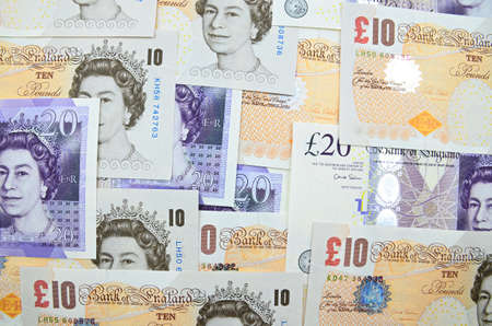 pounds: UK British Pounds banknotes background.