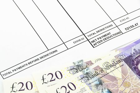 afford: Payslip shows amount of earn with banknotes and coins