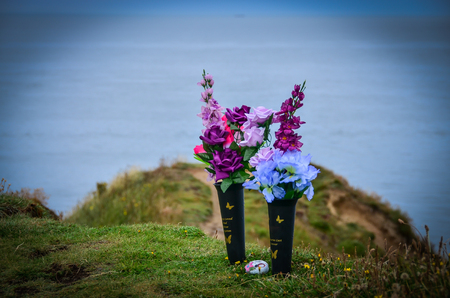 Flowers on the sea shore in remembrance, scatter the ashes of deceased