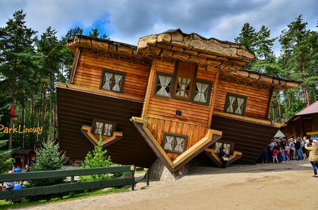 12 August 2016 Szymbark-Poland, Famous touristic attraction in Szymbark open air museum - House on Roof  which can be entered and offers surrealistic and dizzy sensations to visitors. Editorial photo.